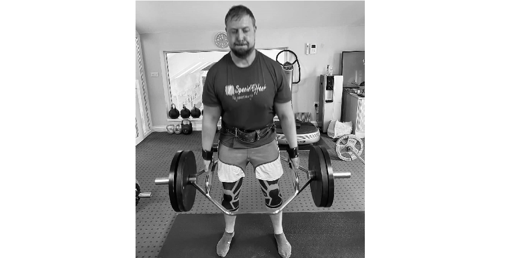 Adam Forder lifting weights for SpecialEffect